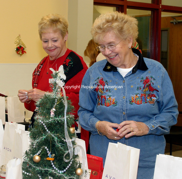 MIDDLEBURY, CT. 10 DECEMBER 11_NEW_121008DA01.jpg- Pat Lucas, from left and Peg Jensen, look over raffle items during an annual Middlebury Senior Center holiday party held at the Shepardson Community Center on Wednesday. <br /> Republican/American   Darlene Douty