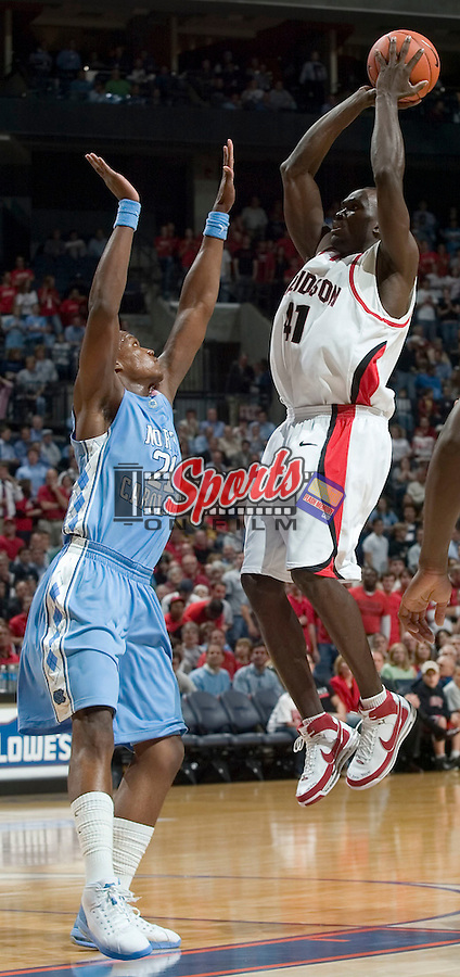 Davidson's Andrew Lovedale (41) shoots a jump shot over North Carolina's Deon Thompson (21) during first half action at Bobcats Arena on Wednesday, November 14, 2007 in Charlotte, NC.