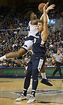 Nevada forward Jordan Caroline (24) shoots over Utah State forward  Tre'Shawn Thurman (0) in the first half of an NCAA college basketball game in Reno, Nev., Wednesday, Jan. 2, 2019. (AP Photo/Tom R. Smedes)