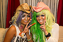 (L to R) Erimokkori, a member of staff poses for pictures with a customer charactered like a Ganguro girl at the Ganguro Cafe &amp; Bar in the Shibuya shopping area on September 4, 2015. <br /> <br /> Ganguro is an alternative Japanese fashion trend which started in the mid-1990s where young women, rebelling against the traditional idea of Japanese beauty, wore colorful make-up and clothes and had dark-skin.<br /> <br /> 10 Ganguro fashion girls work in the new bar, which offers original Ganguro Balls (fried takoyaki style sausage balls in black squid ink batter) on its menu. Ganguro Caf&eacute; &amp; Bar also offers special services such as Ganguro make-up and the chance to take purikura (photo booth pictures) with staff and to look like a Ganguro girl walking around the Shibuya streets.<br /> <br /> The bar is popular with both Japanese and foreigners and has menus translated in English. (Photo by Rodrigo Reyes Marin/AFLO)