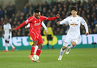 Monday 16 March 2015<br /> Pictured: Liverpool's Raheem Sterling takes on Swansea's Sung-Yeung Ki <br /> Re: Barclay's Premier League, Swansea City FC v Liverpool at the Liberty Stadium, south Wales, UK.