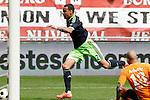 Nederland, Enschede, 29 april 2012.Eredivisie.Seizoen 2011-2012.FC Twente-Ajax.Nikolay Mihaylov (r.), keeper (doelman) van FC Twente brengt Gregory van der Wiel van Ajax ten val, in het strafschopgebied.