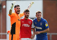 Wimbledon's goalkeeper Tom King and Ben Purrington closely mark Fleetwood Town's Ched Evans<br /> <br /> Photographer Stephen White/CameraSport<br /> <br /> The EFL Sky Bet League One - Fleetwood Town v AFC Wimbledon - Saturday 4th August 2018 - Highbury Stadium - Fleetwood<br /> <br /> World Copyright &copy; 2018 CameraSport. All rights reserved. 43 Linden Ave. Countesthorpe. Leicester. England. LE8 5PG - Tel: +44 (0) 116 277 4147 - admin@camerasport.com - www.camerasport.com