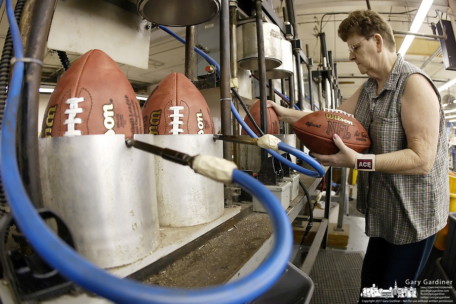 20 January 2005: Ettia Clemmons uses intense air pressure to mold footballs at the Wilson football factory where Super Bowl footballs are made Thursday January 20, 2005 in Ada, Ohio.<br />