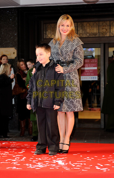 AMANDA HOLDEN.with Adam Wheeler (8).opens Harrods Winter Sale, wearing a wool coat by Catherine Melandrino..Knightsbridge, London, England, UK,.26th December 2009.full length grey gray pattern print waist belt shoes mary janes black child boy.CAP/FIN.©Steve Finn/Capital Pictures.