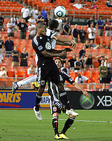 Jordan Graye #16 of D.C. United goes for a header against Alvaro Saborio #15  of Real Salt Lake during an Open Cup match at RFK Stadium, on June 2 2010 in Washington DC. DC United won 2-1.