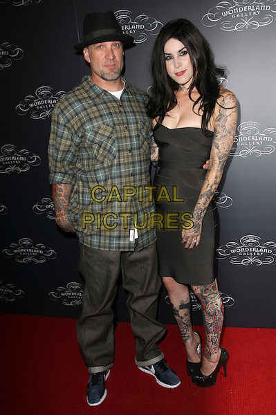 JESSE JAMES & KAT VON D aka Katherine Von Drachenberg.Two Worlds Of Art collide at the Debut of Kat Von D's Wonderland gallery held Wonderland gallery, West Hollywood, CA, USA..September 2nd, 2010.full length black strapless dress tattoos hat green check shirt trousers couple  .CAP/ADM/FS.©Faye Sadou/AdMedia/Capital Pictures.