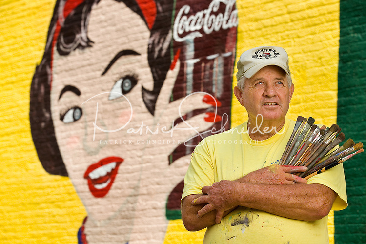 Seventy-two-old Coca-Cola mural painter Andy Thompson, has painted thousands of murals in his 54-years  of working for Coca-Cola. Thompson who started as a painter is now a restorer of the iconic wall murals and advertisements. Thompson was doing some touch-up work on the mural in downtown, Concord, NC.<br />