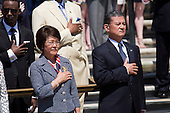 United States Secretary of Veterans Affairs Eric Shinseki (R) and his wife Patricia Shinseki (L) look on during as U.S. President Barack Obama attends a wreath laying ceremony at the Tomb of the Unknown Soldier at Arlington National Cemetery, May 26, 2014 in Arlington, Virginia. President Obama returned to Washington Monday morning after a surprise visit to Afghanistan to visit U.S. troops at Bagram Air Field.<br /> Credit: Drew Angerer / Pool via CNP