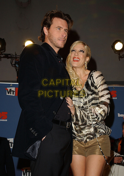 DEAN McDERMOTT & TORI SPELLING.The VH1 Big In '05 Award Show held at The Sony Picture Studios in Culver City, California .December 3rd, 2005.Ref: DVS.half length gold shorts animal print top black suit.www.capitalpictures.com.sales@capitalpictures.com.Supplied By Capital PIctures