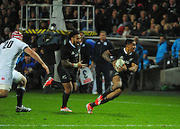 Malakai Fekitoa attacks with Ma'a Nonu in support during the Steinlager Series international rugby match between the New Zealand All Blacks and England at Waikato Stadium, Hamilton, New Zealand on Saturday, 14 June 2014. Photo: Dave Lintott / lintottphoto.co.nz