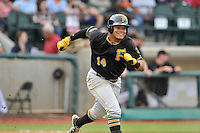 First baseman Jhoan Herrera (14) of the Bristol Pirates runs out a ground ball in a game against the Pulaski Yankees on Tuesday, July 5, 2016, at Calfee Park in Pulaski, Virginia. Pulaski won, 6-3. (Tom Priddy/Four Seam Images)