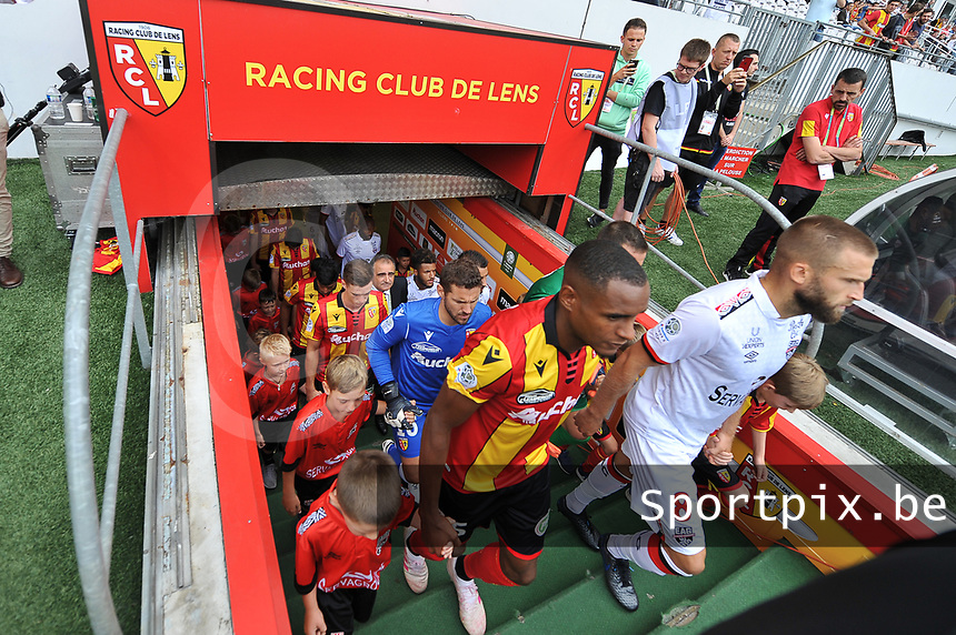 20190803 - LENS , FRANCE : illustration picture shows players entering the pitch witk Lucas Deaux (R) and Steven Fortes (L) pictured during the soccer match between Racing Club de LENS and En Avant Guingamp , on the second matchday in the French Dominos pizza Ligue 2 at the Stade Bollaert Delelis stadium , Lens . Saturday 3 th August 2019 . PHOTO DIRK VUYLSTEKE | SPORTPIX.BE