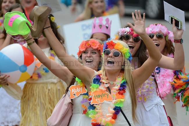 Delta Delta Delta sisters celebrate as they approach their new house during Bid Day in Lexington, Ky., on Friday, August 22, 2014. Photo by Caleb Gregg | Staff