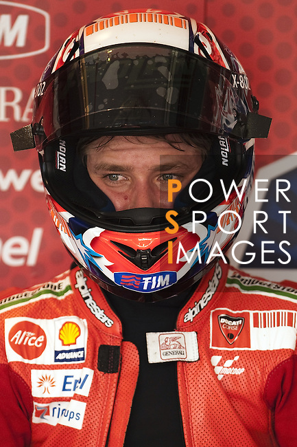 KUALA LUMPUR, MALAYSIA - OCTOBER 24:  Casey Stoner of Australia looks on in his pit garage during qualifying for the Malaysian MotoGP, which is round 16 of the MotoGP World Championship at the Sepang Circuit on October 24, 2009 in Kuala Lumpur, Malaysia. Photo by Victor Fraile / The Power of Sport Images