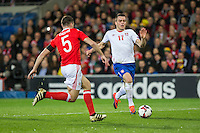 Filip Kostic of Serbia runs at James Chester of Wales during the FIFA World Cup Qualifying match between Wales and Serbia at the Cardiff City Stadium, Cardiff, Wales on 12 November 2016. Photo by Mark  Hawkins.