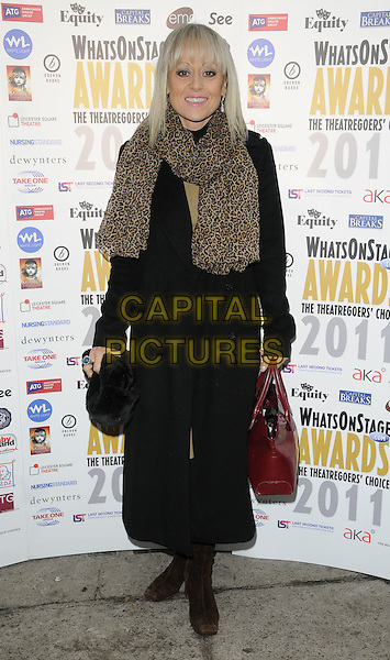 TRACIE BENNETT .At the Whatsonstage.com Awards Concert Launch Party, Cafe De Paris, London, England, UK, .3rd December 2010..full length leopard animal print scarf red bag black coat .CAP/CAN.©Can Nguyen/Capital Pictures.