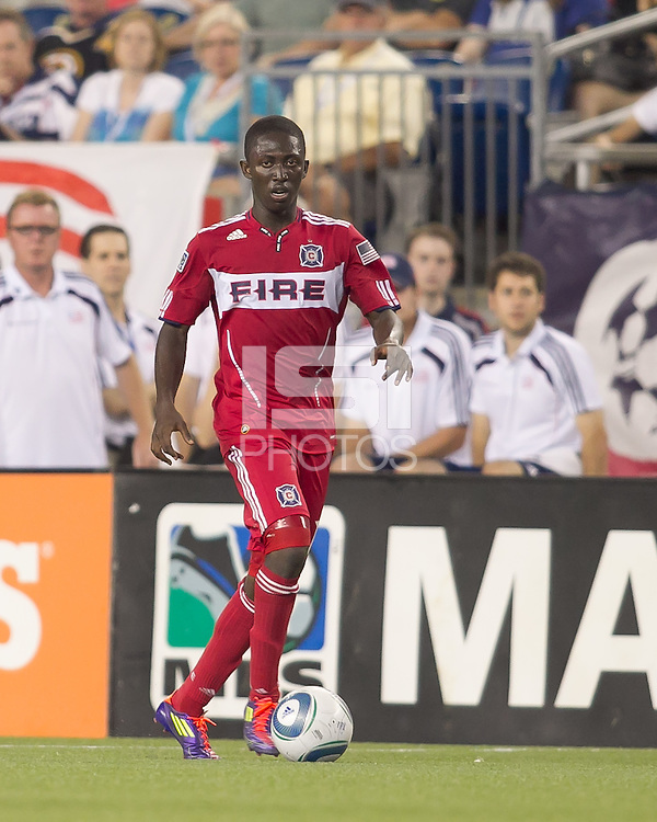Chicago Fire midfielder Patrick Nyarko (14) dribbles down the wing. In a Major League Soccer (MLS) match, the New England Revolution tied the Chicago Fire, 1-1, at Gillette Stadium on June 18, 2011.