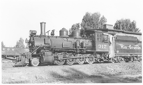 Fireman's-side view of D&amp;RGW #317 at Montrose engine house.<br /> D&amp;RG  Montrose, CO  Taken by Maxwell, John W. - 5/30/1948