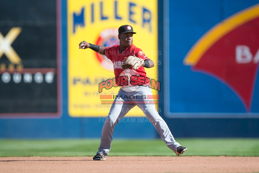 Vancouver Canadians shortstop Jesus Severino (10) throws to first base during a Northwest League game against the Spokane Indians at Avista Stadium on September 2, 2018 in Spokane, Washington. The Spokane Indians defeated the Vancouver Canadians by a score of 3-1. (Zachary Lucy/Four Seam Images)