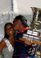 A champane soaked J.W. Myers kisses the regatta queen..Madison Regatta, Madison Indiana July 3, 2005.Photo Credit: ©F.Peirce Williams 2005