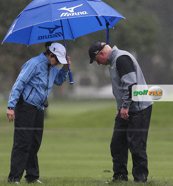 Richard Finch (ENG) looks for somewhere playable accompanied by Rule Official during Round One of The Nelson Mandela Championship 2013 presented by ISPS Handa, at the Mount Edgecombe Country Club, KwaZulu-Natal, South Africa. Picture:  David Lloyd / www.golffile.ie