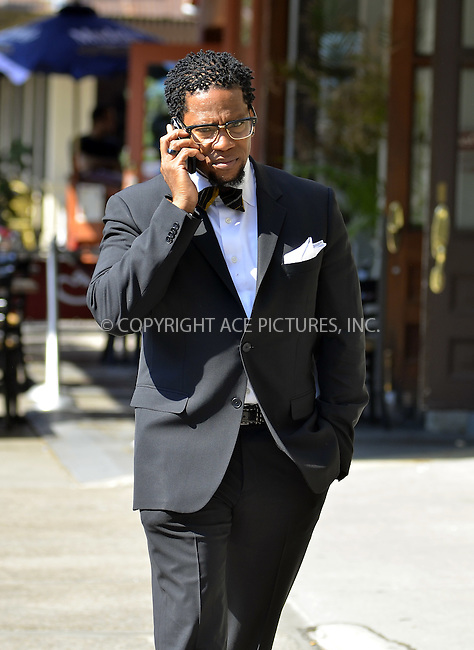 WWW.ACEPIXS.COM . . . . .  ....July 10 2012, New York City....Actor and comedian DL Hughley walks and talks in Tribeca on July 10 2012 in New York City....Please byline: CURTIS MEANS - ACE PICTURES.... *** ***..Ace Pictures, Inc:  ..Philip Vaughan (212) 243-8787 or (646) 769 0430..e-mail: info@acepixs.com..web: http://www.acepixs.com