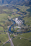 Wenatchee River, U.S. 2, Pear Orchards in upper Wenatchee Valley at Peshastin..Washington State, Chelan County.   Large buildings are fruit warehoues.  Aerial taken in May 2009