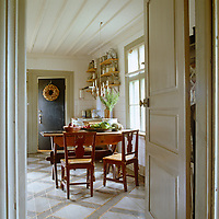 Seen through an open door the pleasingly simple kitchen of this country house