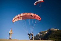 Saint Vincent-les-Forts, Lac de Serre Poncon, France, September 2007. Instructors Roland ter Harkel and Gijsbert Hoogerkamp, guide an advanced student into the air. Volantis is home to the paragliding school Inferno. In one week time, students learn to fly the paraglider and earn their mountain licence 1. Photo by Frits Meyst/Adventure4ever.com
