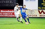 2016-01-09 / Voetbal / Seizoen 2015-2016 / Oosterzonen - Grimbergen / Redouan Benhamou (l. Oosterzonen) met Rodrigue Williot<br /><br />Foto: Mpics.be