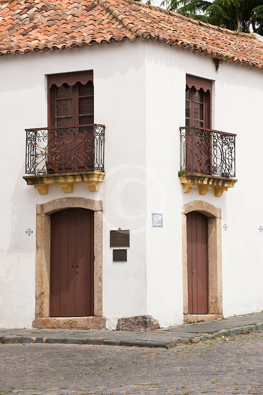 Uruguay, Colonia del Sacramento, Ornate balcony, street corner, Historic District
