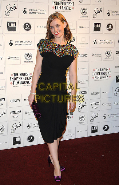 ANNE-MARIE DUFF .Attending The British Independent Film Awards,The Brewery, London, England, UK, December 6th 2009..arrivals full length black dress gold multi-coloured sequin sequined  purple silk satin shoes clutch .CAP/CAS.©Bob Cass/Capital Pictures.
