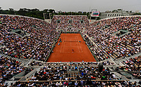 PARIS, FRANCE - JUNE 05: Novak Djokovic of Serbia serves to Marco Cecchinato of Italy in the Quarter Finals of the men's singles during the French Open at Roland Garros on June 5, 2018 in Paris, France. (Photo by Mike Frey/Getty Images)
