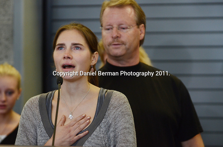 Amanda Knox is overcome with emotion as she begins her address to the media upon her arrival in the United States at Seattle-Tacoma International Airport in Seattle Tuesday, October 4. Knox's murder conviction was overturned by an Italian appellate court after spending four years in prison in Italy. Photo by Daniel Berman/www.bermanphotos.com