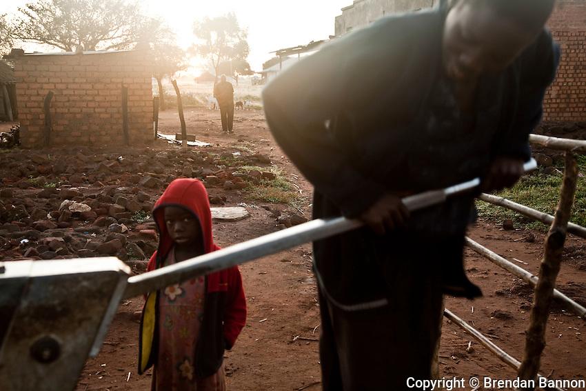 Children fetching water in the morning in Madi Opei, northern Uganda.