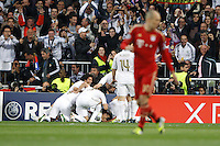 25.04.2012 SPAIN -  UEFA Champions League Semi-Final 2nd leg  match played between Real Madrid CF vs  FC Bayern Munchen 2 (1) - 1 (3) at Santiago Bernabeu stadium. The picture show players  Real Madrid CF celebrating his team's goal