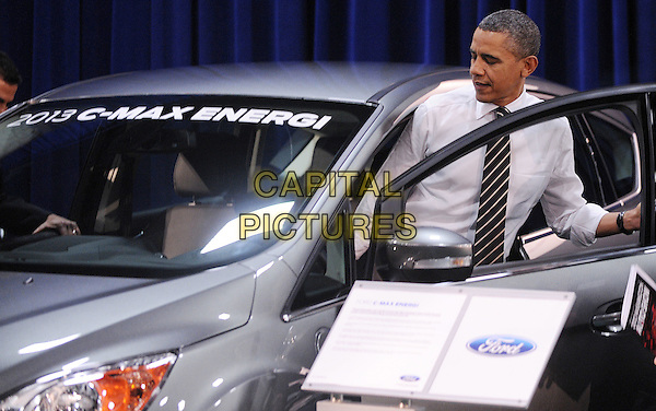 United States President Barack Obama looks at cars during a visit to the DC Auto Show at the Walter E. Washington Convention Center in Washington, DC on January 31, 2012.  .CAP/ADM/OD.©Olivier Douliery/Pool/CNP/AdMedia/Capital Pictures