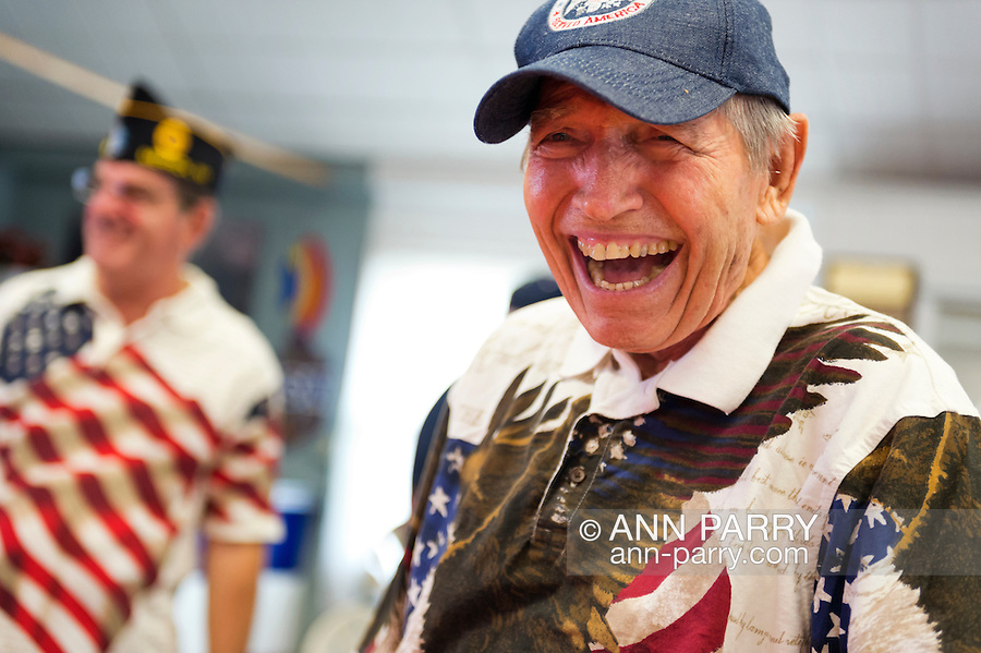 AUG. 11, 2012 - MERRICK, NEW YORK, U.S. - LENNY TUCKER (at right), a member of American Legion Merrick Post 1282, is laughing at barbecue the post hosted for vets from Long Island State Veterans Home at Stony Brook University.