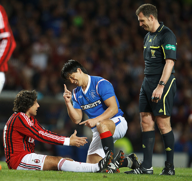 Michael Mols has a message for Federico Giunti after being fouled by the Milan man as referee John McKendrick watches the pair