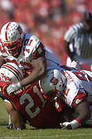 21 October 2006:  N.C. State DTs DeMarcus Tank Tyler (72) and  DeMario Pressley (92) stop the Maryland RB behind the line of scrimmage.  The Maryland Terapins defeated the N.C. State Wolfpack 26-20 October 21, 2006 at Chevy Chase Bank Field at Byrd Stadium in College Park, MD.