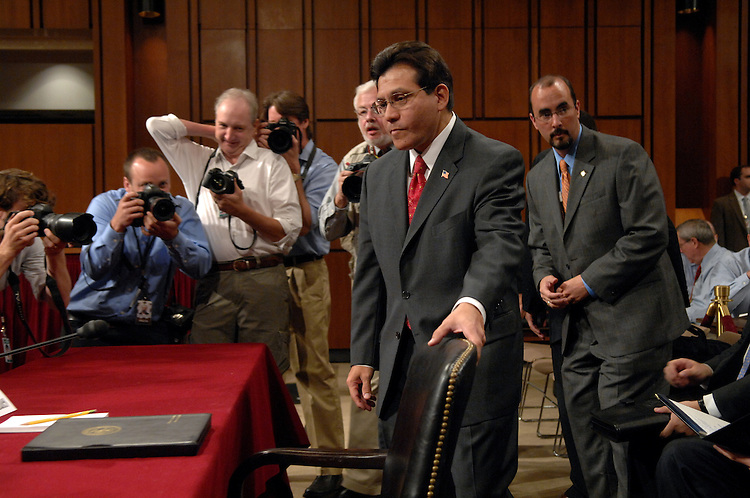 Attorney General Alberto Gonzales arrives at a Senate Judiciary Committee hearing on oversight of the Department of Justice.