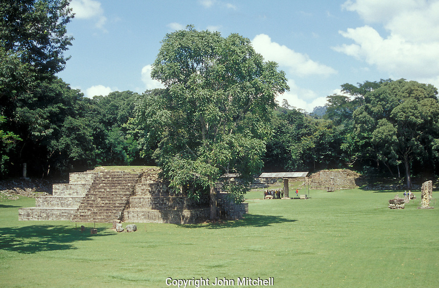 Tourists in the Great Plaza at the Mayan ruins of Copan, Honduras