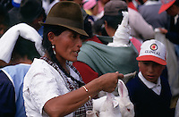 A woman selling rabbits in Tambillo Market.