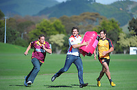 Horowhenua-Kapiti's Ryan Shelford passes a Pink Batt bale to King Country's Brian Mansfield (left) as Thames Valley's Blake Hill (right) runs in support during the Pink Batts Heartland Championship 2013 season launch at Waikanae RFC, Waikanae, New Zealand on Tuesday, 13 August 2013. Photo: Dave Lintott / lintottphoto.co.nz