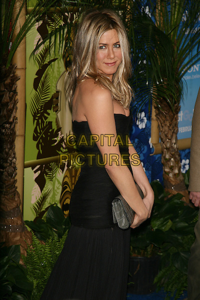 "JENNIFER ANISTON.The New York Premiere of ""Just Go With It"" at the Ziegfeld Theater, New York, NY, USA..February 8th, 2011.half length strapless black dress clutch bag grey gray croc bustier sheer see thru through side.CAP/LNC/TOM.©TOM/LNC/Capital Pictures."