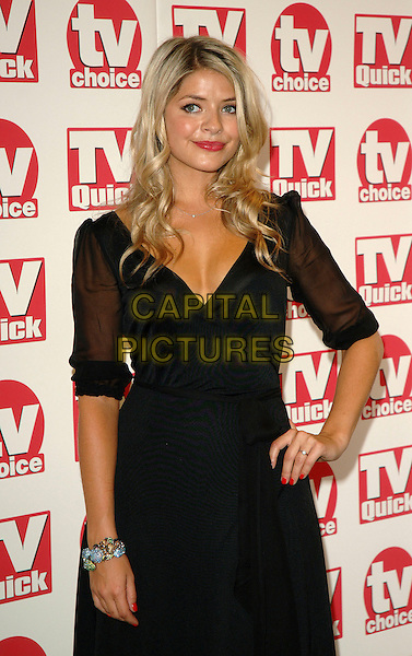HOLLY WILLOUGHBY.The TV Quick and TV Choice Awards, The Dorchestr, London, UK..September 4th, 2006.Ref: BEL.half length black dress sheer sleeves hand on hip.www.capitalpictures.com.sales@capitalpictures.com.©Tom Belcher/Capital Pictures.