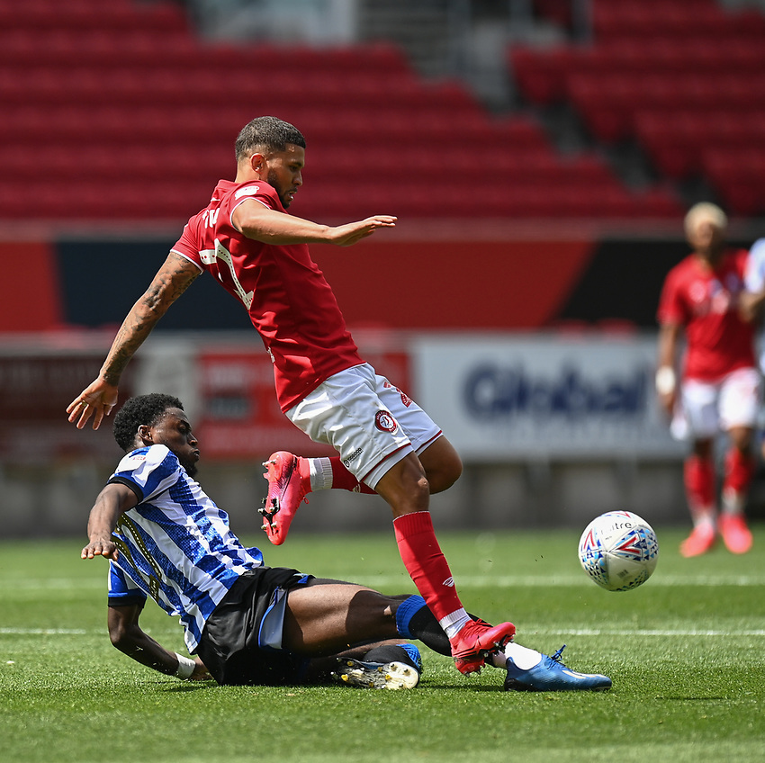 Bristol City's Nakhi Wells (right) is tackled from behind by Sheffield Wednesday's Moses Odbubajo <br /> <br /> Photographer David Horton/CameraSport<br /> <br /> The EFL Sky Bet Championship - Bristol City v Sheffield Wednesday - Sunday 28th June 2020 - Ashton Gate Stadium - Bristol <br /> <br /> World Copyright © 2020 CameraSport. All rights reserved. 43 Linden Ave. Countesthorpe. Leicester. England. LE8 5PG - Tel: +44 (0) 116 277 4147 - admin@camerasport.com - www.camerasport.com