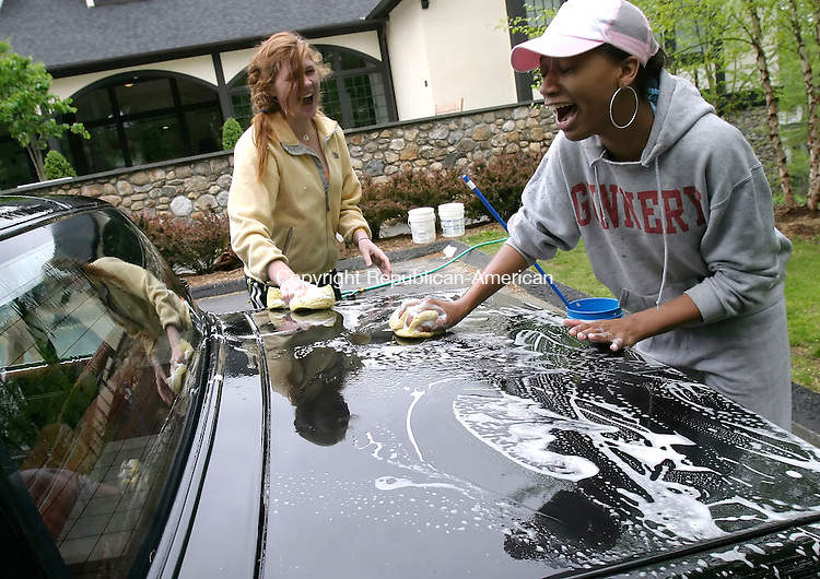 WASHINGTON, CT, 14 May 2006- 051406BZ03- Gunnery students Emily Sandefer, 15, gr. 10, of New Orleans, LA, left, and Danielle McDonald, 16, gr. 10, of South Orange, NJ,  share a laugh while working at a car wash to raise money for the Model UN and the Debate Club Sunday.  The event was held at the Gunnery. Sandefer is a member of the Model UN.  <br /> Jamison C. Bazinet Republican-American