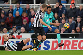 4th November 2017, St James Park, Newcastle upon Tyne, England; EPL Premier League football, Newcastle United Bournemouth; Joshua King of AFC Bournemouth skips a challenge from Jonjo Shelvey of Newcastle United with Florian Lejeune of Newcastle United also trying to stop him in the second half of the 0-1 win